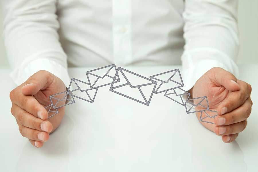 Man depicting letters and emails flying between his hands