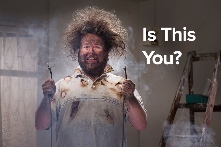 A funny picture of a shocked man holding two smoking electrical cables, for a post called Dumb Ways to Seek Donations.