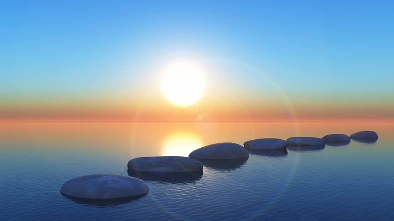 Calm ocean with stepping stones
