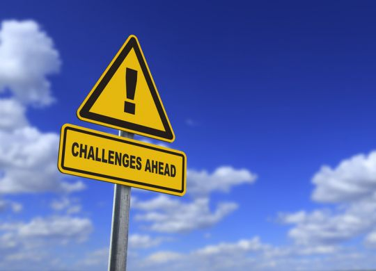 """A sign says """"challenges ahead."""" Some planned giving marketing challenges?"""