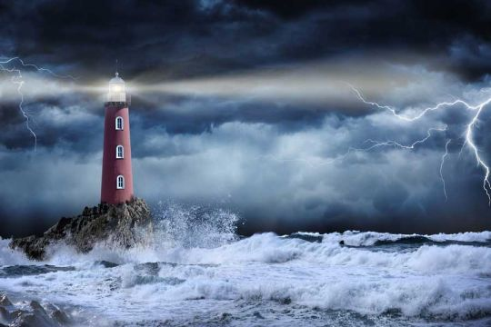 Lighthouse In Stormy Weather Depicting Future of Philanthropy