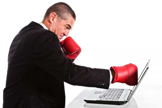 executive punching monitor to mimic website hits
