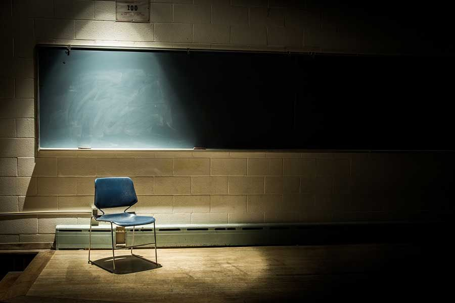 Blackboard with empty seat. whats holding you back.